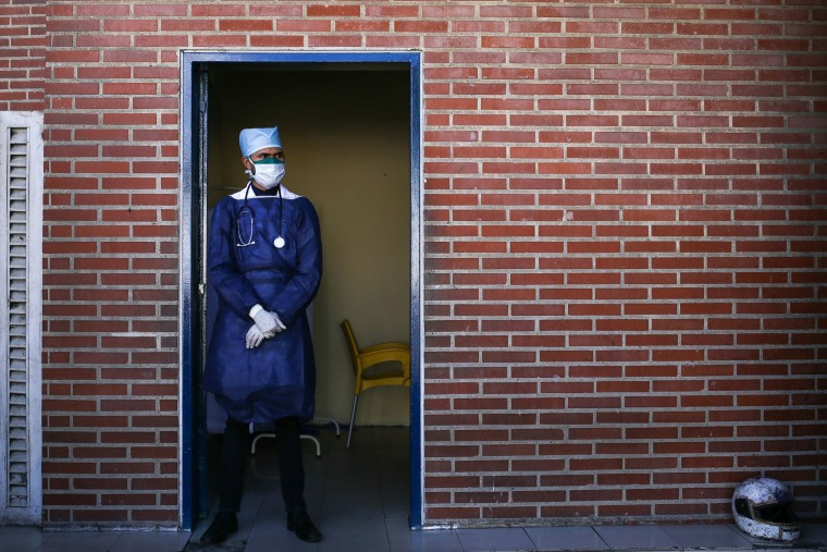 Image: A doctor wears a face mask at the Ana Francisca Perez de Leon hospital in Caracas