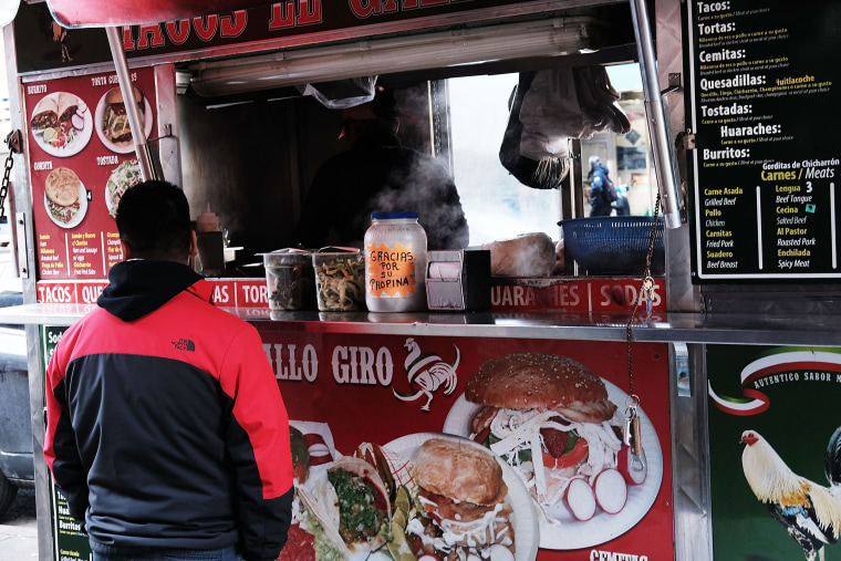 A food cart selling traditional Mexican food in the Jackson Heights neighborhood of New York