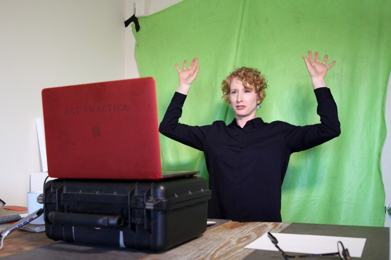 Image: Lisa Wymore, a professor of dance, theater and performances studies at University of California, Berkeley leads warm-ups for an online course