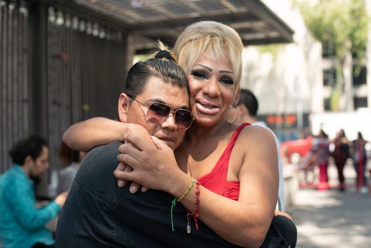 Ann Scarlett Vargas, right, and Hector Aaron Roman celebrate their marriage in a collective wedding in Mexico City on March 14, 2020.