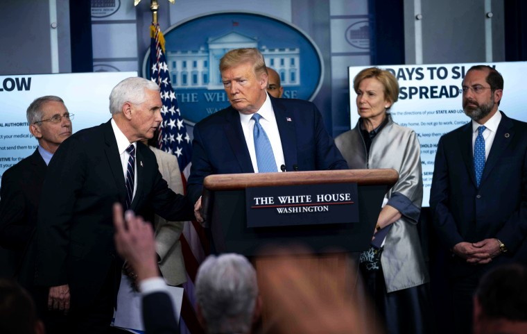 Image: President Donald Trump listens to Vice President Mike Pence during a press conference on the coronavirus at the White House on March 16, 2020.