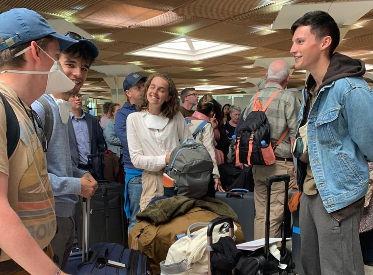 Image: From left, Jacob Muscarella, Nicholas Nerli, Michelle Monheit and Alex Walsh at Agadir airport in Morocco on Wednesday hoping to board a flight back to the U.S.