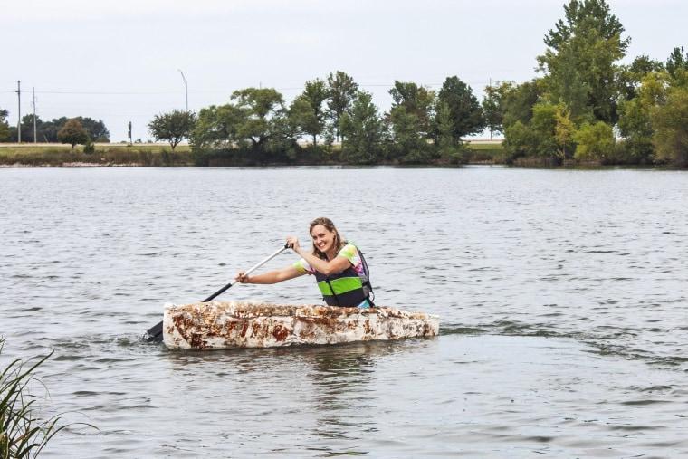 Katy Ayers paddles her canoe on a Nebraska lake.