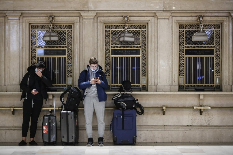 Image: Travelers on their smartphones at Grand Central Terminal in New York