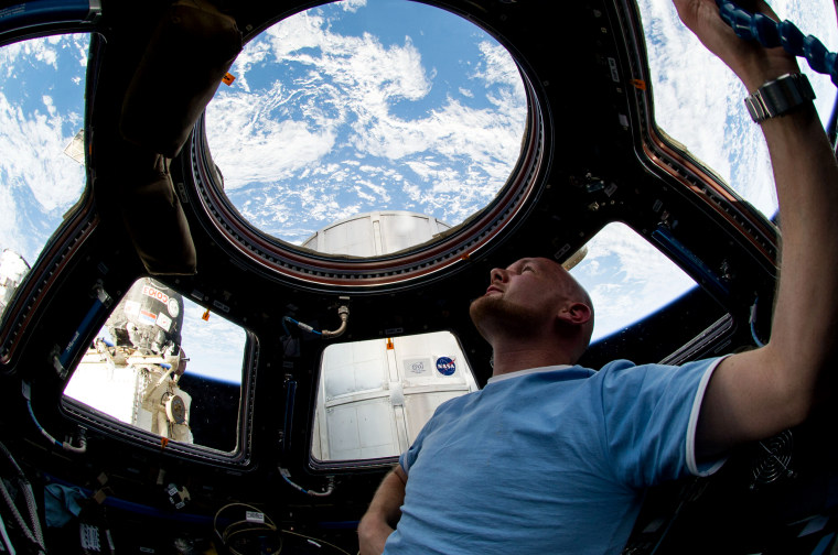Image: European Space Agency astronaut Alexander Gerst, Expedition 40 flight engineer, enjoys the view of Earth from the windows in the Cupola of the International Space Station.
