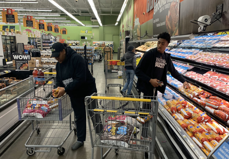 Volunteers from Good Kids Mad City in Chicago buy groceries.