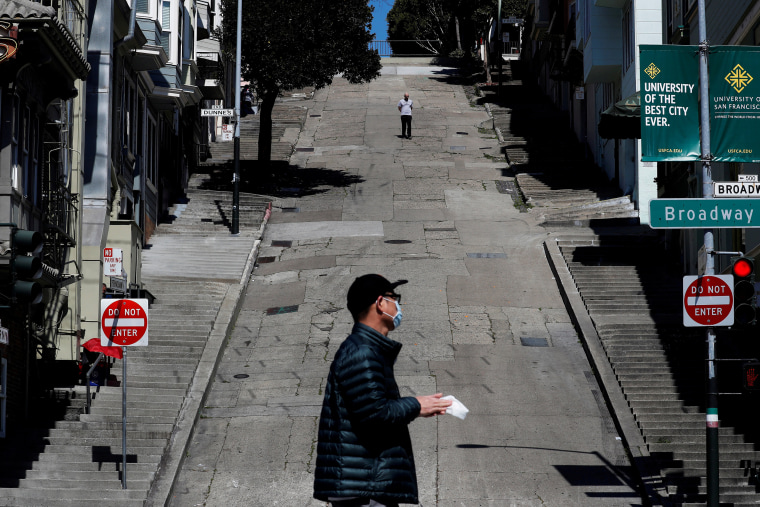 Image: People walk on the streets in San Francisco