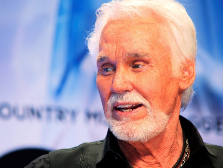Image: FILE PHOTO: Kenny Rogers poses backstage after accepting the Willie Nelson Lifetime Achievement award at the 47th Country Music Association Awards in Nashville