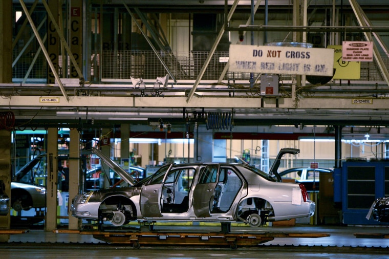 Image: A Cadillac DTS sedan makes its way down the assembly line at the General Motors Co. Detroit-Hamtramck plant in Detroit, Michigan.