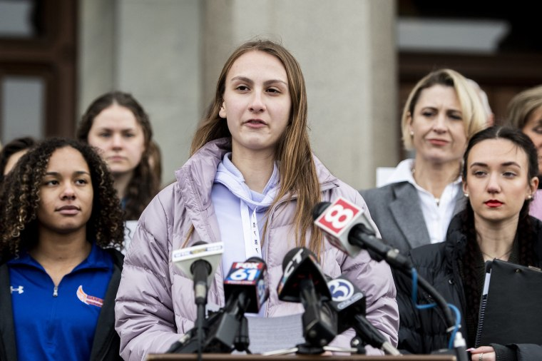 Image: From left, Alanna Smith, Danbury High School sophomore, Canton High School senior Chelsea Mitchel and Selina Soule, Glastonbury High School senior, speak during a press conference at the Connecticut State Capitol