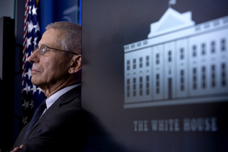 Image; Anthony Fauci, director of the National Institute of Allergy and Infectious Diseases, listens during a Coronavirus Task Force news conference at the White House on March 21, 2020.