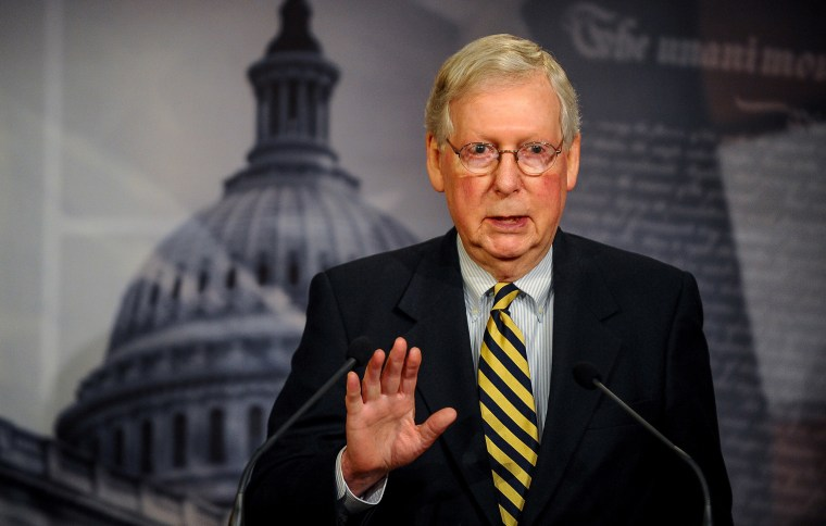 Image: Senate Majority Leader Mitch McConnell (R-KY) speaks to the media after a meeting to wrap up work on coronavirus economic aid legislation, during the coronavirus disease (COVID-19) outbreak, in Washington