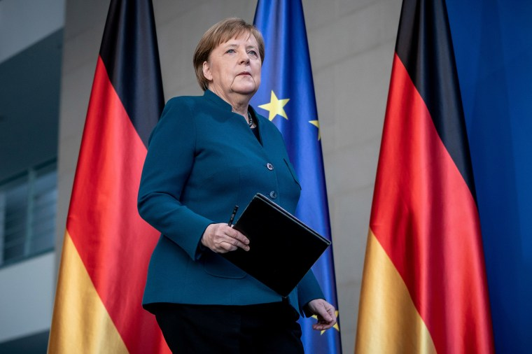 Image: German Chancellor Angela Merkel arrives for a media statement on the spread of coronavirus at the Chancellery in Berlin, Germany