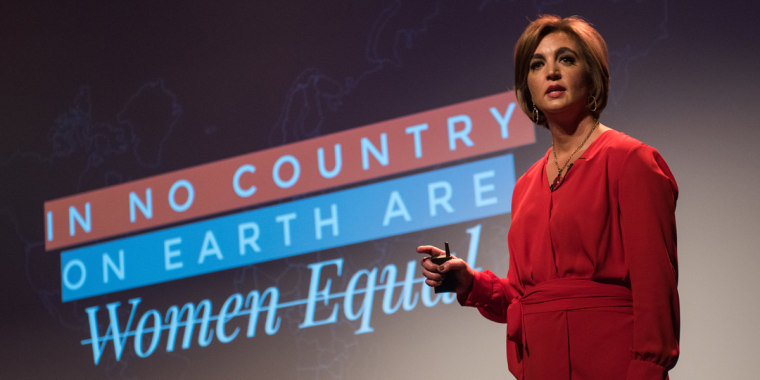 Gender economist Katica Roy presenting on stage.