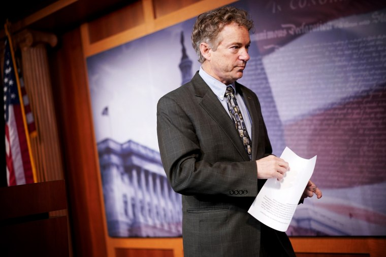 Image: Sen. Rand Paul, R-Ky., leaves a press conference on Capitol Hill on Jan. 30, 2020.