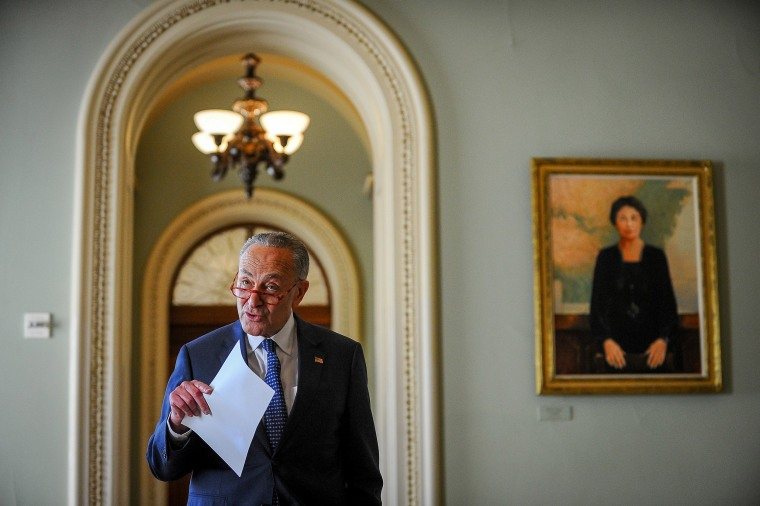 Image: U.S. Senate Minority Leader Chuck Schumer (D-NY) makes a statement after meetings to wrap up work on coronavirus economic aid legislation, during the coronavirus disease (COVID-19) outbreak, in Washington