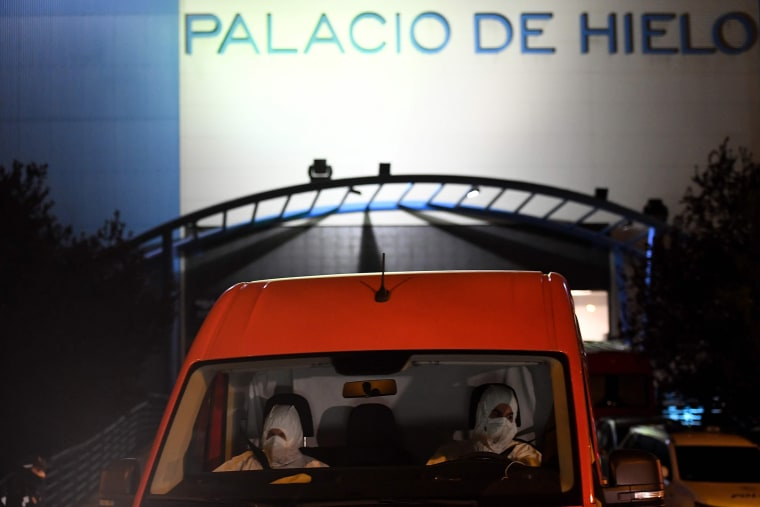 Image: Members of the Spanish Army's Military Emergency Unit outside Madrid's Palacio de Hielo shopping mall on Monday where an ice rink is being turned into a temporary morgue to help deal with the city's surge in coronavirus-related deaths.