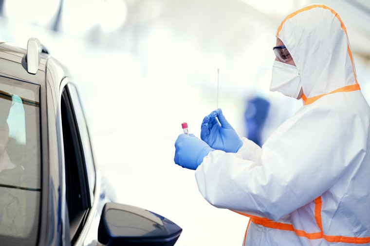 Image: A medical worker administers a coronavirus test on a patient at a mobile testing center in Baden-Wuerttemberg, Germany, on March 18, 2020.
