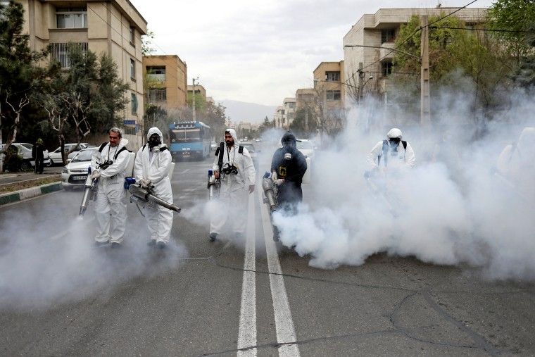 Image: FILE PHOTO: Members of firefighters wear protective face masks, amid fear of coronavirus disease, as they disinfect the streets, ahead of the Iranian New Year Nowruz, March 20, in Tehran