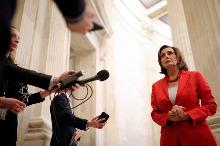 Image: Speaker of the House Pelosi speaks to news reporters ahead of a vote on the coronavirus relief bill on Capitol Hill in Washington