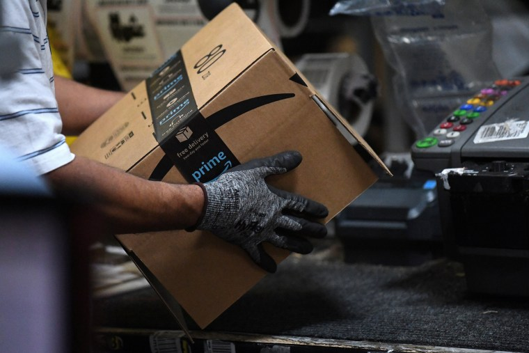 Image: A worker assembles a box for delivery at the Amazon fulfilment center in Baltimore