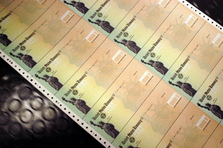 Image: Checks run through the printer at the U.S. Treasury printing facility in Philadelphia in 2005.