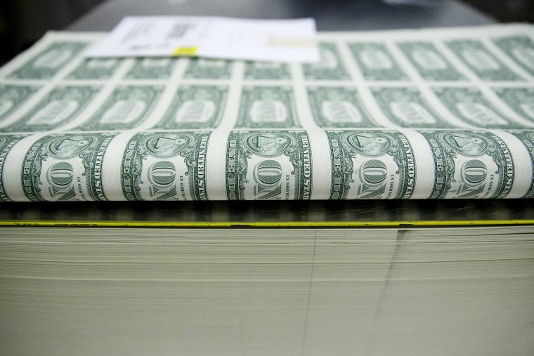 Operations At The Bureau Of Engraving And Printing As The $1 Bill Is Printed