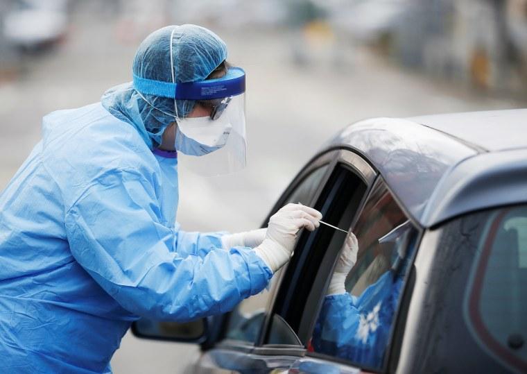 Image: A coronavirus testing site outside International Community Health Services during the coronavirus disease (COVID-19) outbreak in Seattle