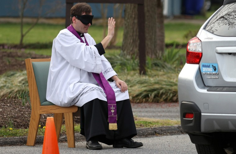 Image: Priest In Maryland Offers Drive Thru Confession As Communities Across Country Encouraged To Practice Social Distancing To Stop Spread Of Coronavirus