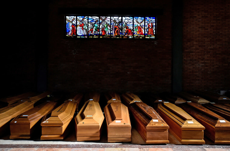 Image: Coffins of people who have died from coronavirus disease (COVID-19) are seen in the church of the Serravalle Scrivia cemetery