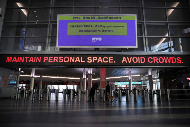 Image: A warning sign at Whitehall Terminal warns ferry riders to practice social distancing while commuting during the outbreak of the coronavirus disease (COVID-19) in Manhattan, New York City