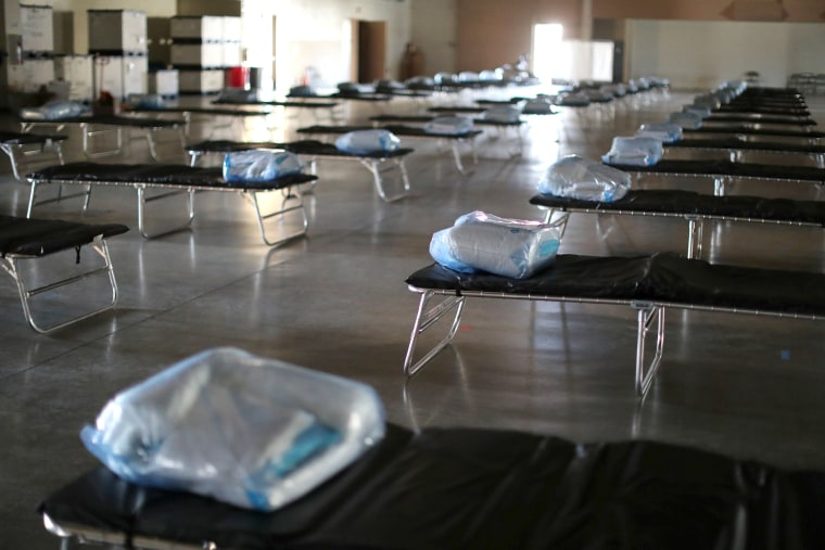 Image: A federal medical station for up to 125 coronavirus disease (COVID-19) patients is set up to ease strain at county hospitals, in Indio, California