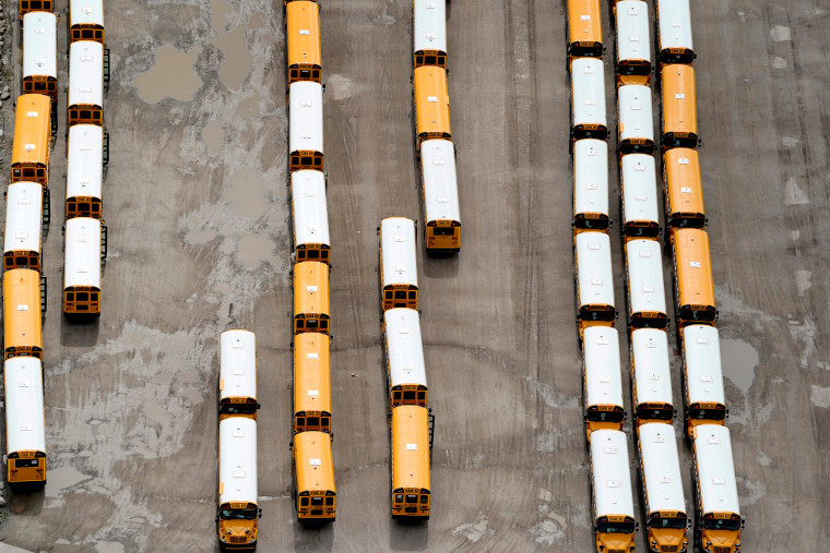 Image: School buses wait to be shipped at the IC of Oklahoma Tulsa Bus Plant in Tulsa