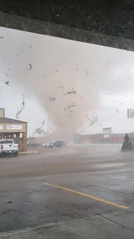 Tornado tears through Arkansas city, prompting curfew and National Guard response