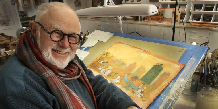 Author Tomie dePaola poses with his artwork in his studio in New London, N.H. on Dec. 1, 2013. His literary agent says dePaola died Monday from surgery complications after taking a bad fall last week.