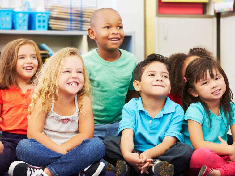 Group of children listening to teacher