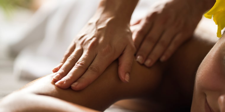 Close up of receiving relaxing massage at the spa.