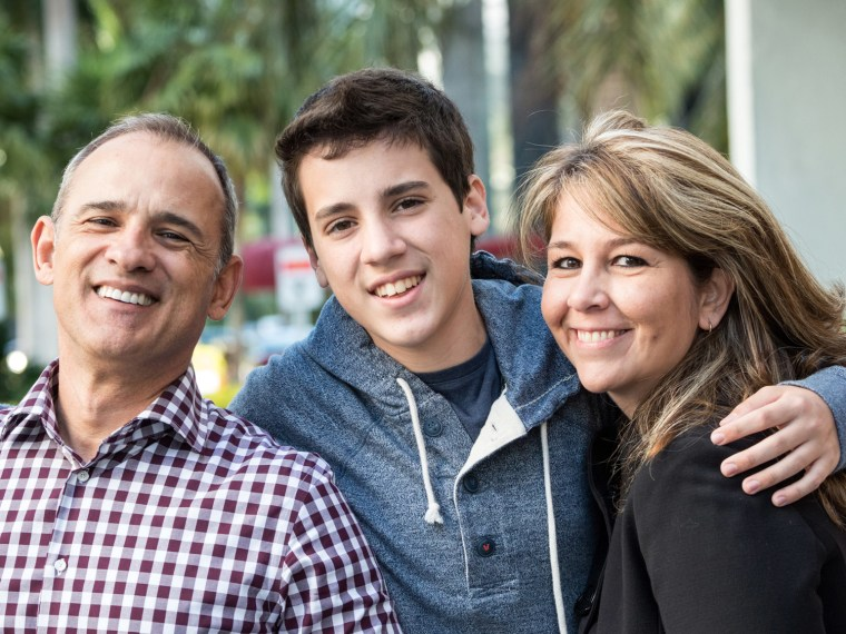 Young college student with his parents