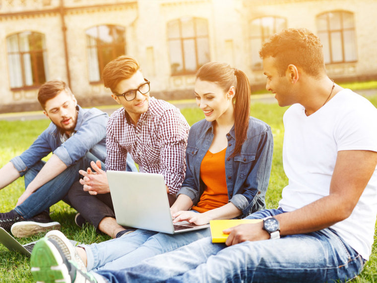 Four college students work outside
