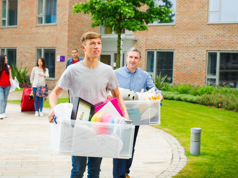 College student moving into dorm with parent