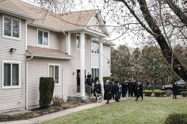 People gather at Rabbi Chaim Rottenberg's residence in Monsey, New York, on Dec. 29, 2019.