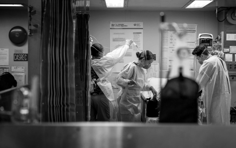 Image: A patient is treated aboard the USNS Mercy hospital ship in Los Angeles on March 29, 2020.