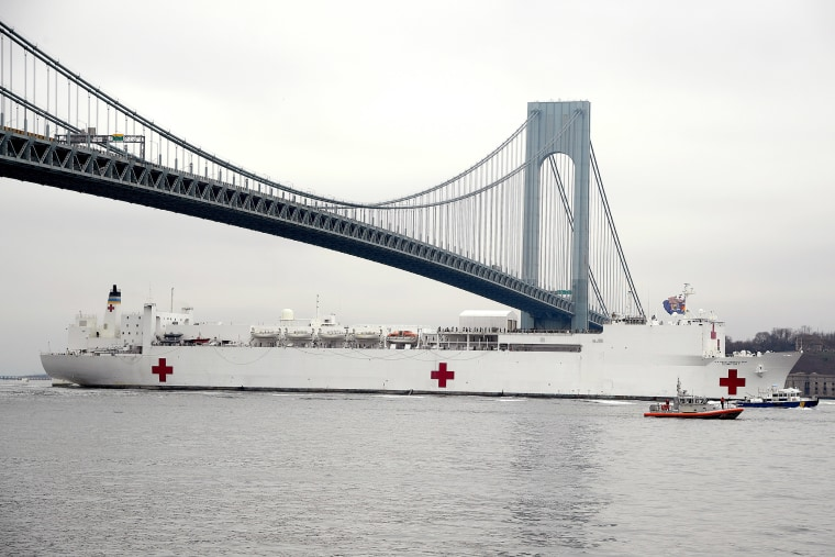 Image: Navy Hospital Ship USNS Comfort travels under the Verrazzano-Narrows Bridge as it heads to Pier 90 as the coronavirus pandemic continues to overwhelm medical infrastructure
