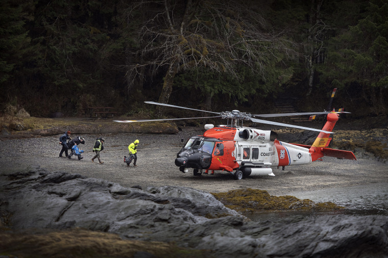 Image: A U.S. Coast Guard helicopter waits to airlift Ketchikan Volunteer Rescue personnel to search for Jaxson Brown, a missing 5-year-old-boy, in Alaska on March 28, 2020.