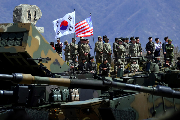 Image: U.S. and South Korean soldiers watch a drill at the Seungjin Fire Training Field near Seoul in 2017.