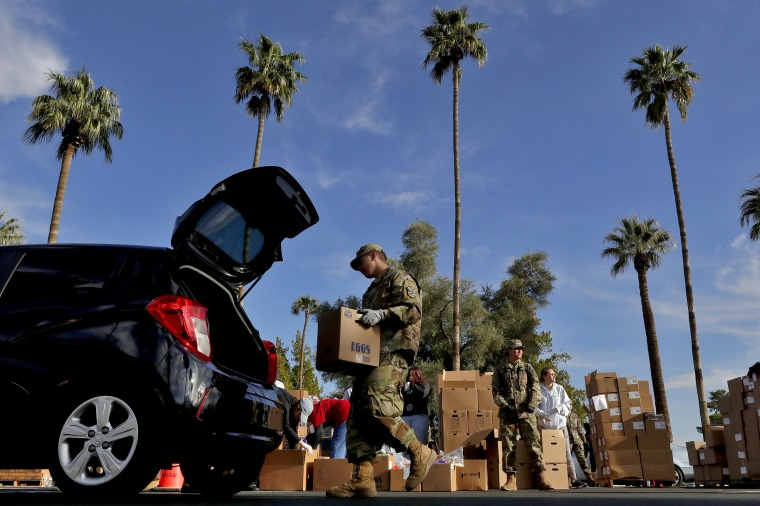 Image: Members of the Arizona National Guard distribute food in Mesa on March 27, 2020.