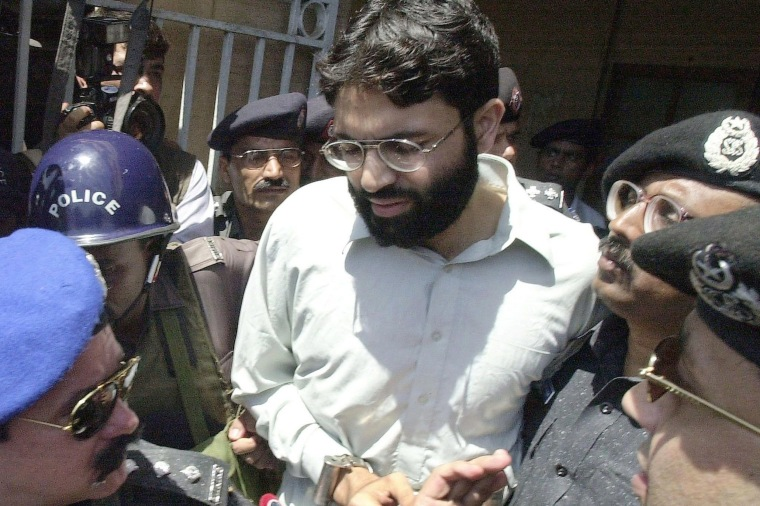 Image: Pakistani police surround a handcuffed Ahmed Omar Saeed Sheikh as he comes out of a court in Pakistan's port city of Karachi