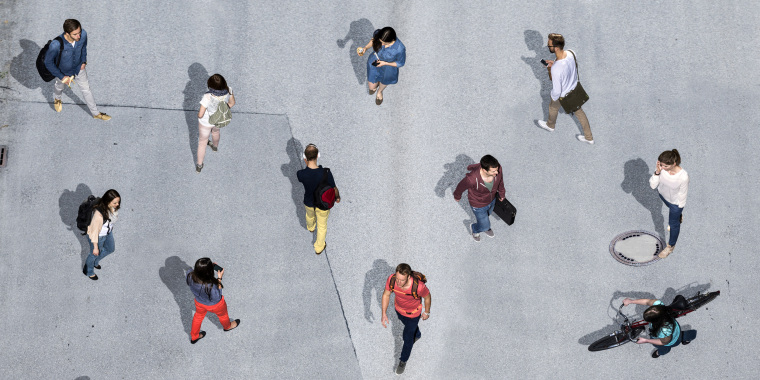 Image: Group of young People walking in different directions