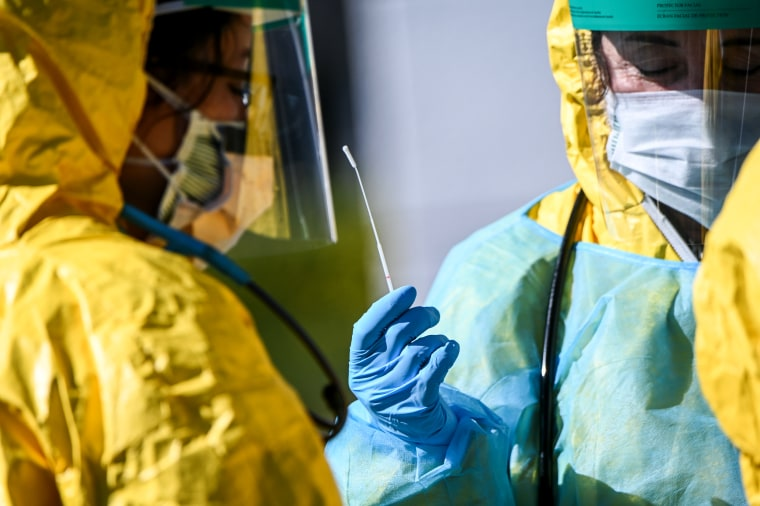 Image: Health workers in personal protective gear at a coronavirus testing site in Jericho, N.Y., on March 24, 2020.