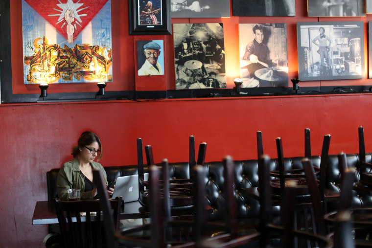 Image: Susan Upton, 53, works on her computer at her family restaurant Mambos, which is being forced to close after 32 years, due to the global outbreak of the coronavirus disease (COVID-19), in Glendale